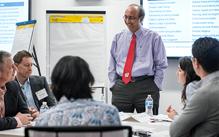 Dean Samba interacts with WSB alumni at a board meeting.