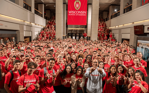 Dean Sambamurthy stands among 500 incoming undergraduate students in red t-shirts
