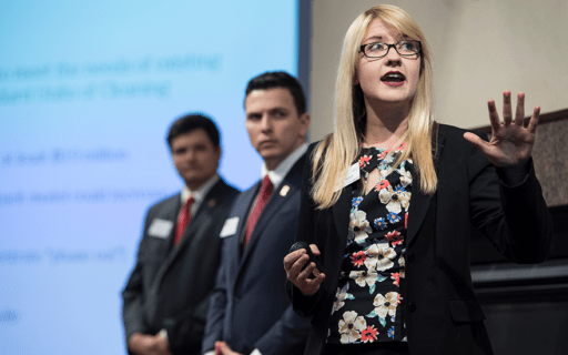 Wisconsin MBA students present on a stage