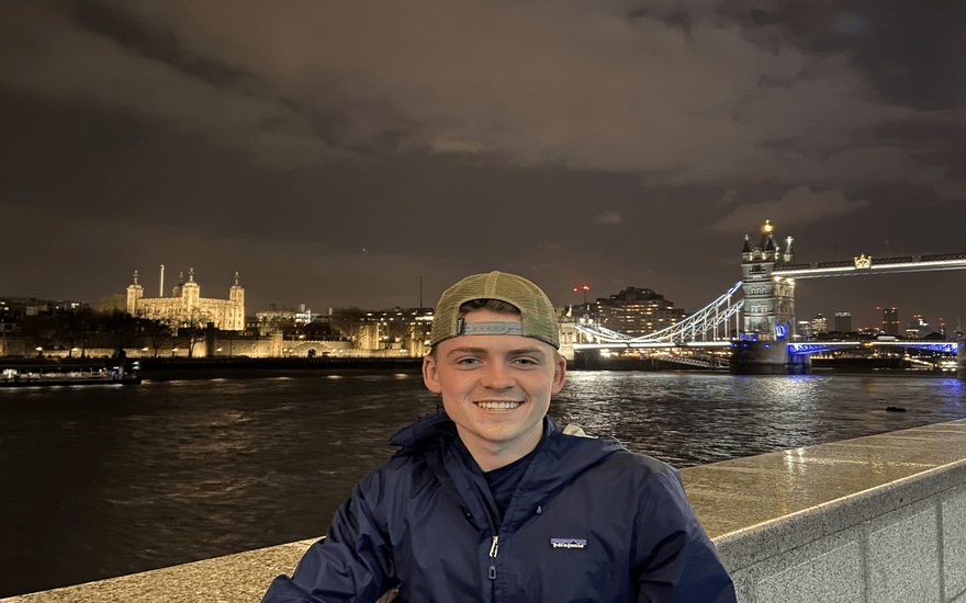 Student standing near River Thames in London, England