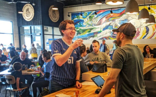 Customer ordering at Working Draft Brewery