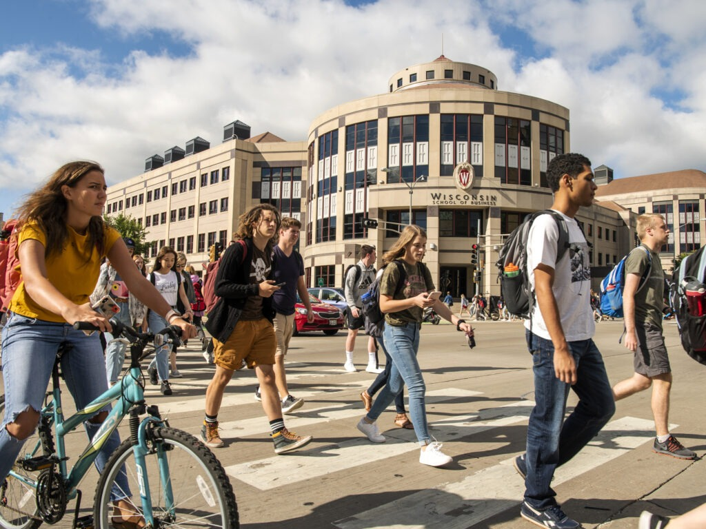 Students crossing the street in front of Grainger Hall