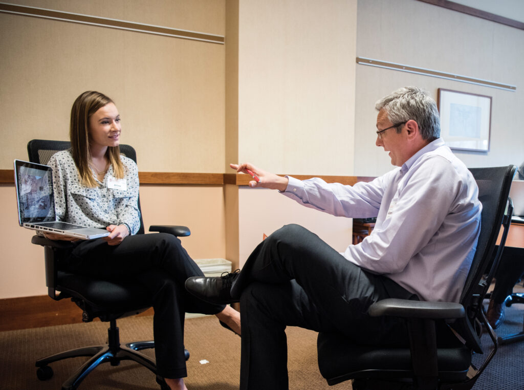 Advisor consulting an alumni