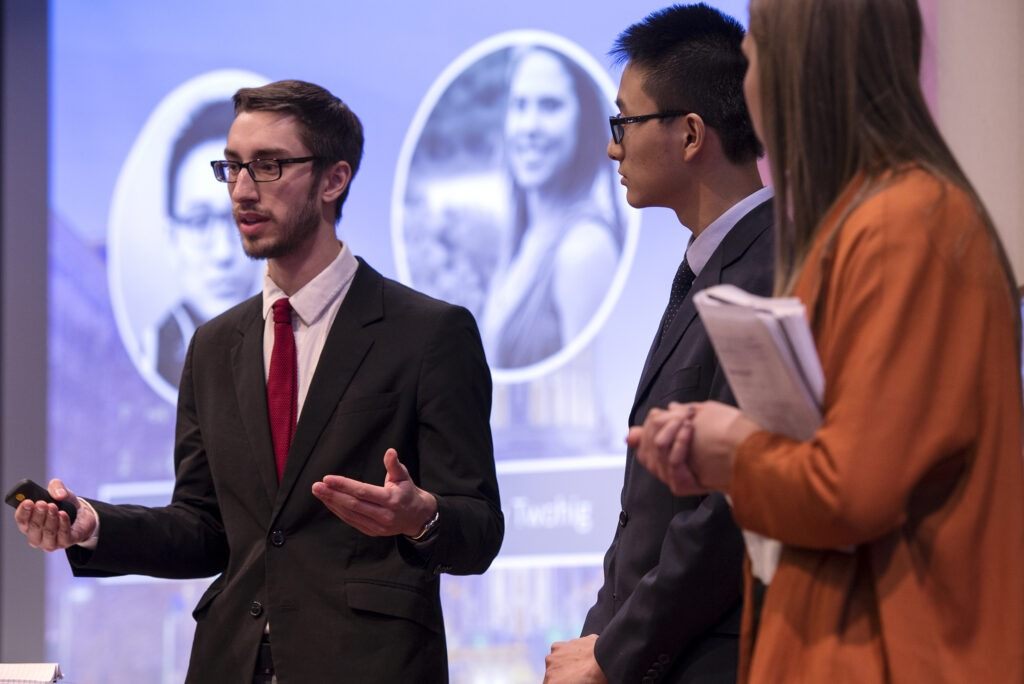 Students presenting at the Hult Prize competition