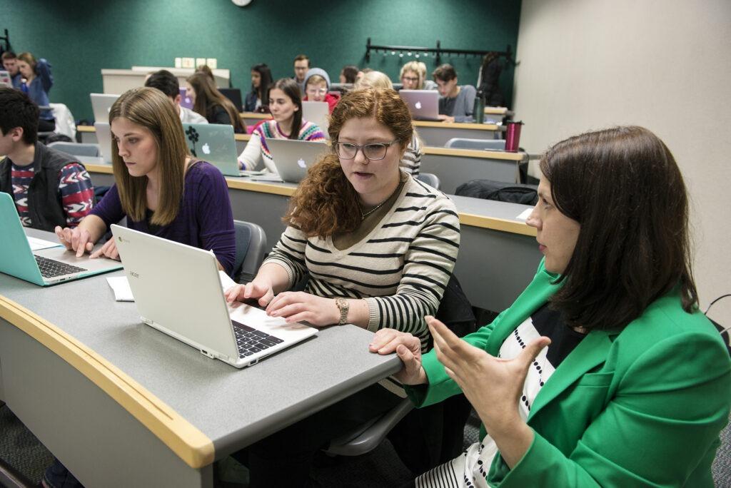 Student receiving help from Professor Krueger