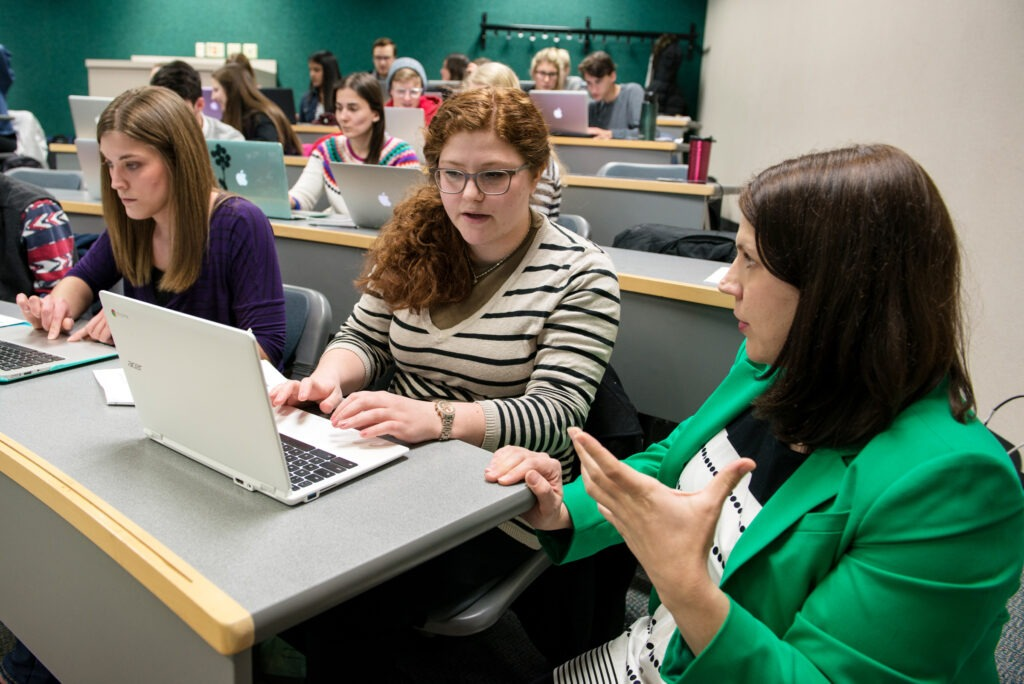 Professor Katie Krueger helping students
