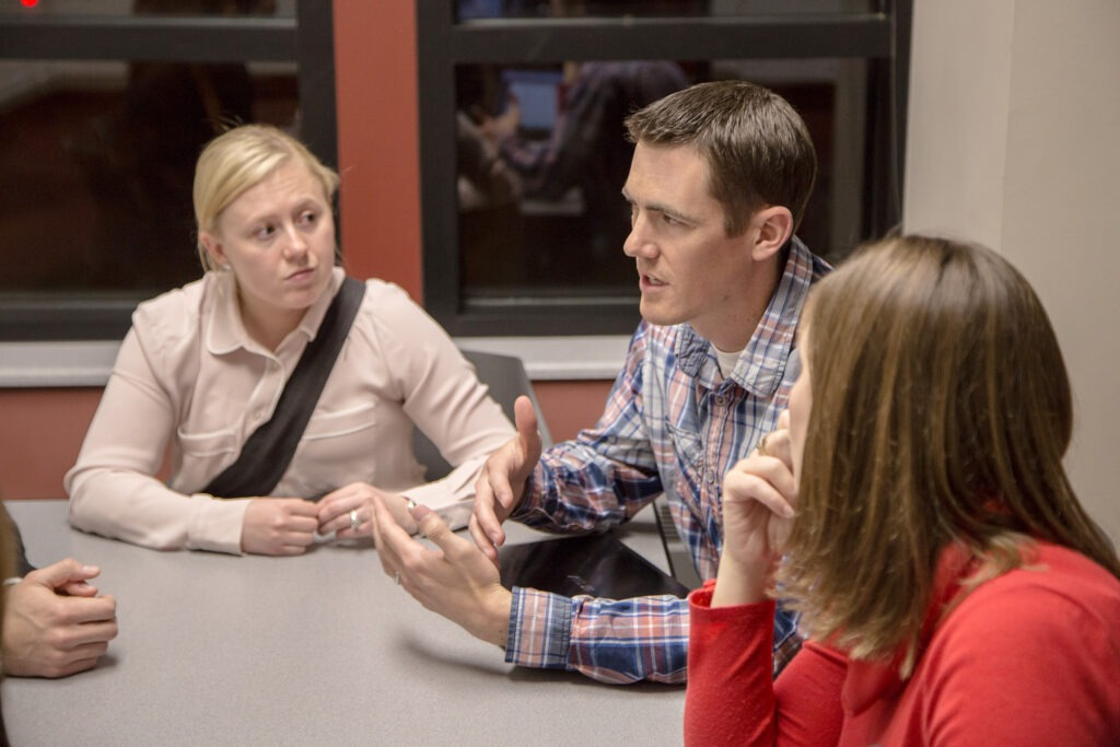 three MBA students having a discussion