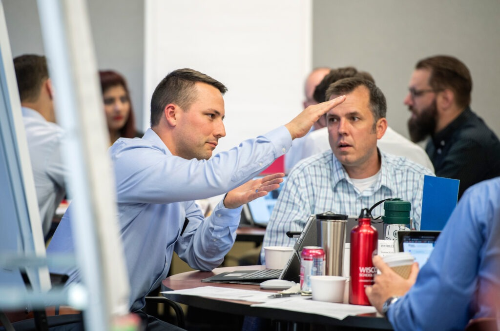 Executive MBA students participate in a Professional Team Development event during Immersion Week in Grainger Hall on Monday, August 19, 2019. (Paul L. Newby, II /UW-Madison Wisconsin School of Business)