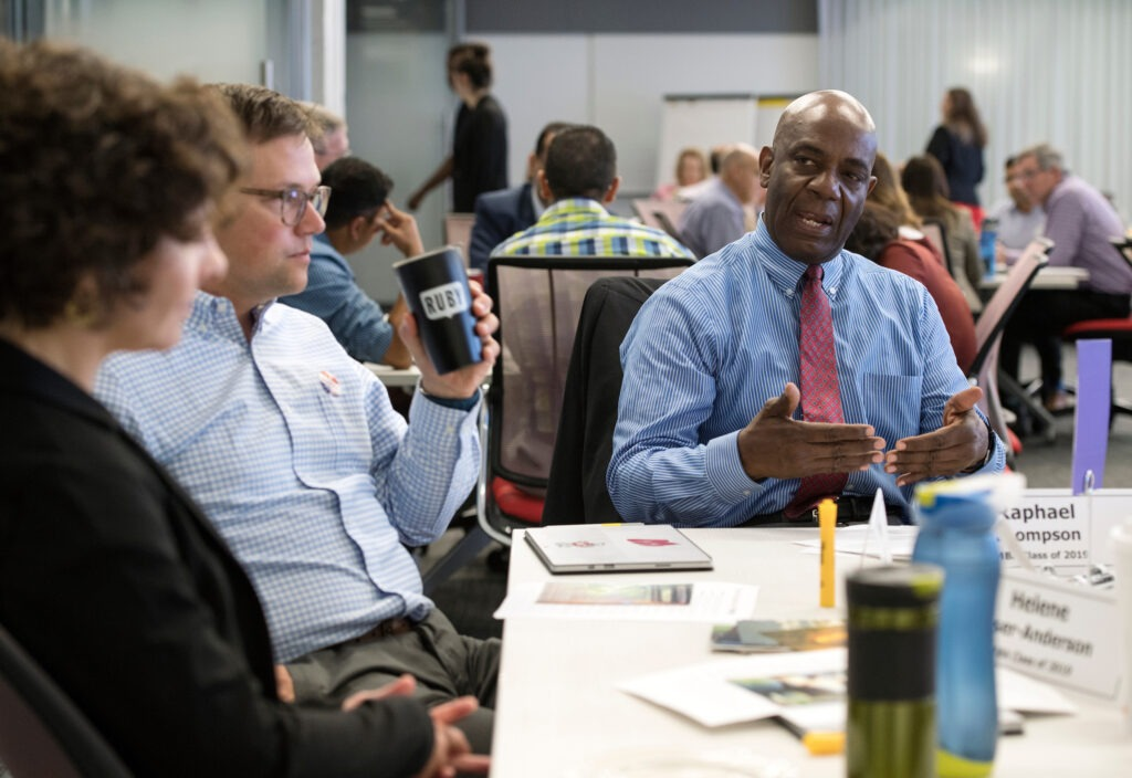 Executive MBA student Ray Thompson networks with classmates during the Business Strategy class on Tuesday, August 14, 2018. (Paul L. Newby, II /UW-Madison Wisconsin School of Business)