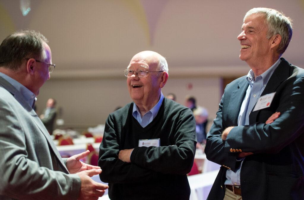 three board members talking