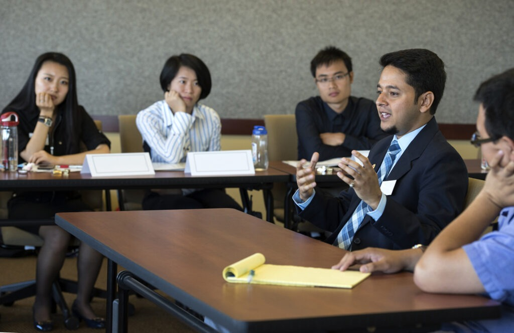 MBA students at a panel discussion