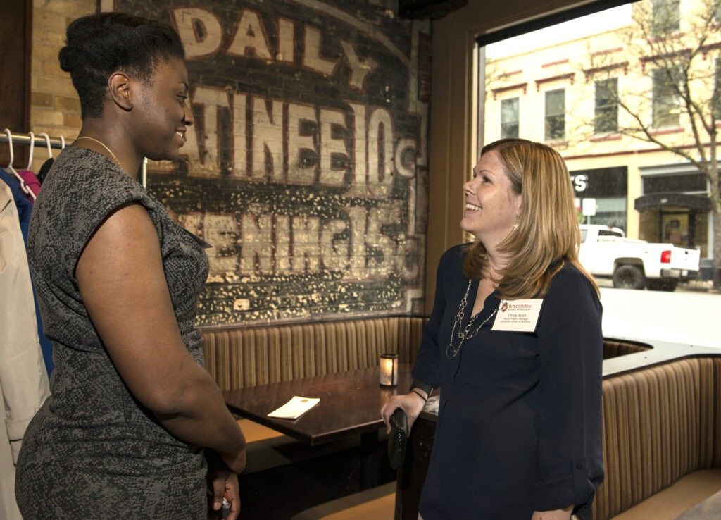 Cindy Bush and Camille Clark talk to each other at the Wisconsin Women in Business Networking Social