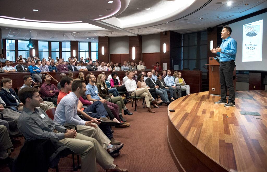 Jia Jiang speaking to people at Full-time MBA Weikel Speaker Series
