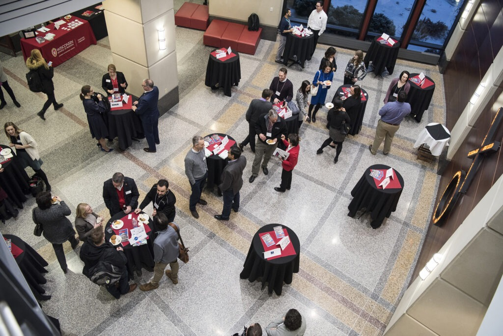 aerial view of students at tables during corporate connections