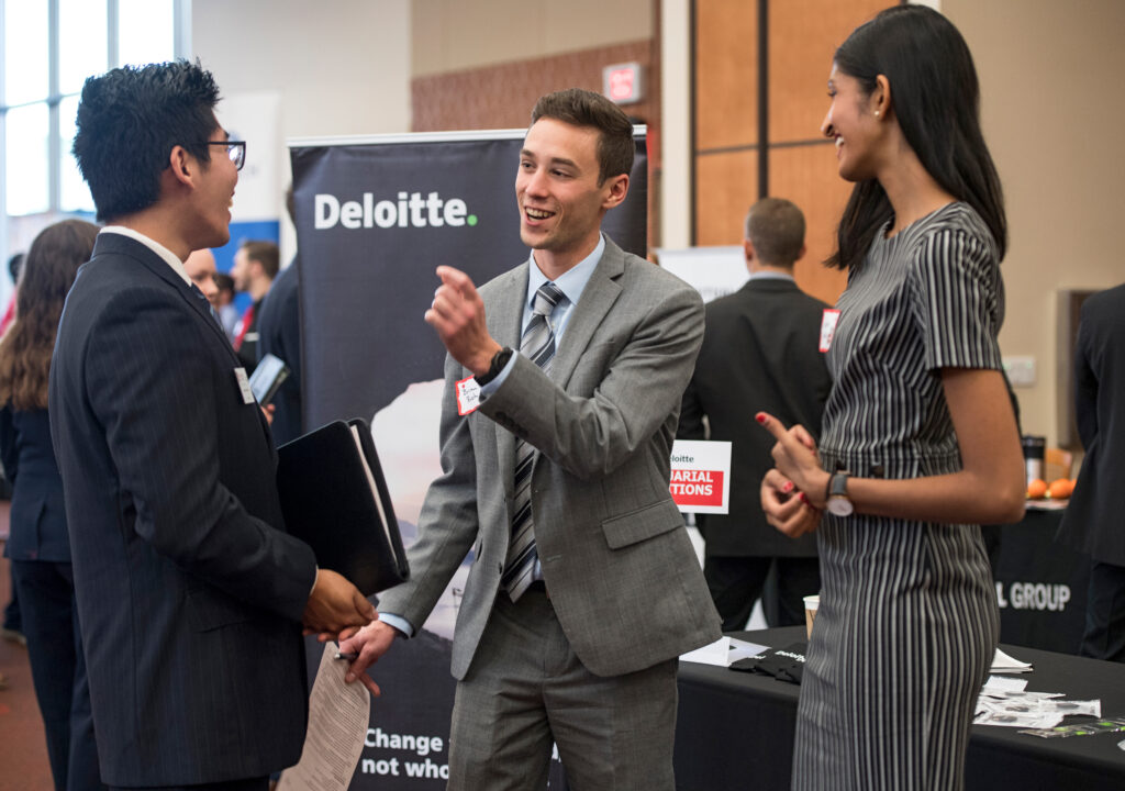 Student networking at a career fair