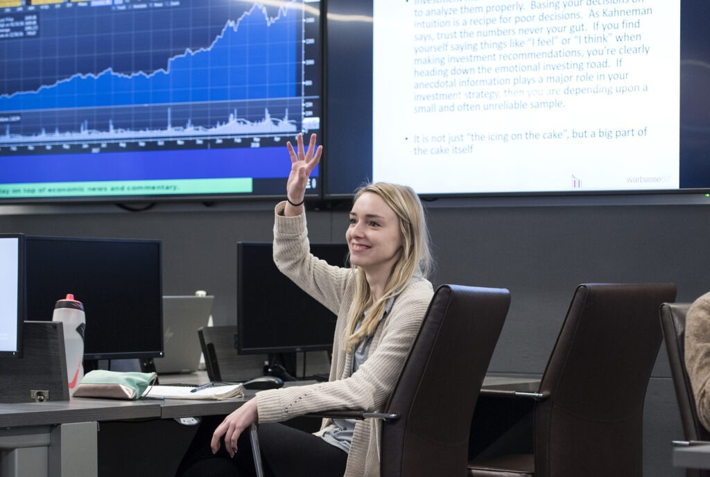 student raises hand in learning commons classroom