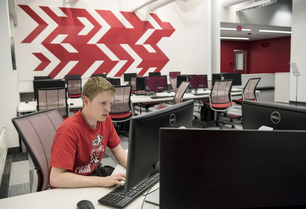 BBA student studying for his finals on the first floor of the new Learning Commons.
