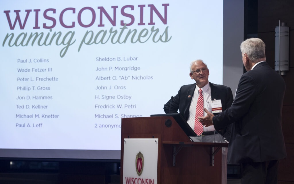 Ted Kellner, one of the Wisconsin Naming Partners, speaking at a podium