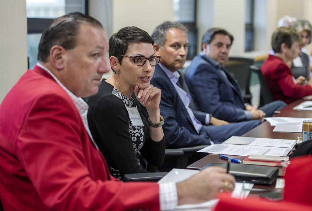 Board members talk at a meeting