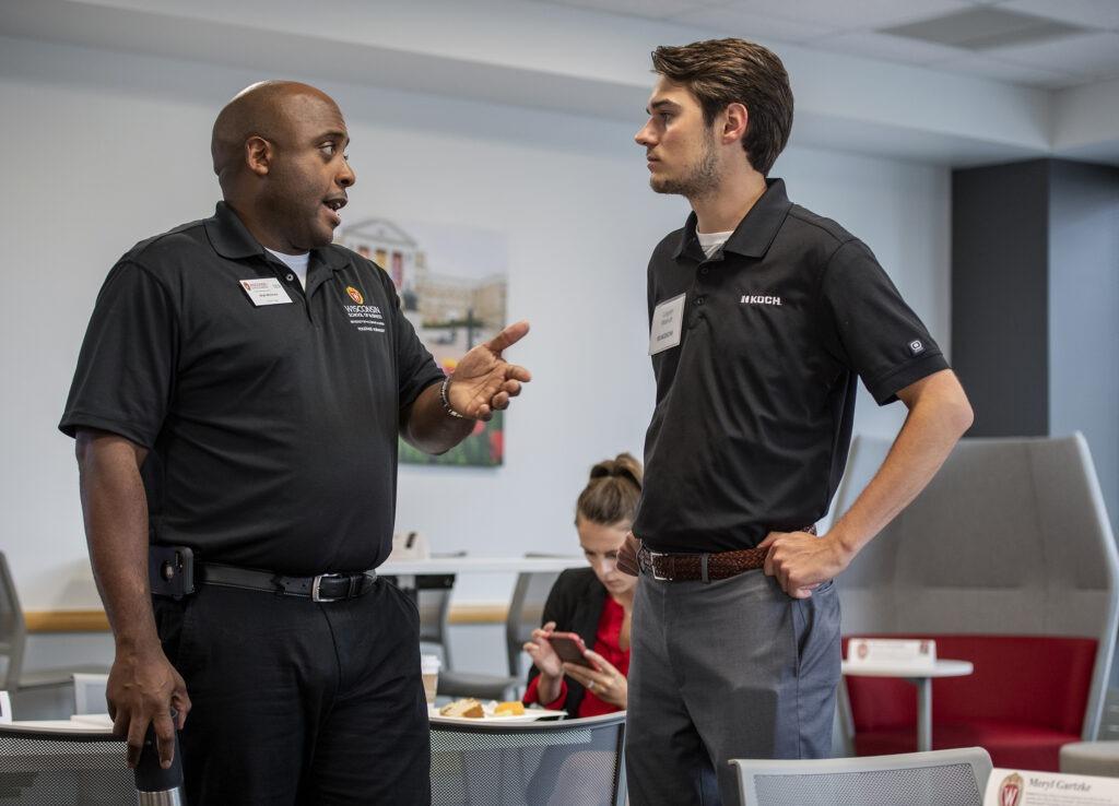 Two WSB staff talking
