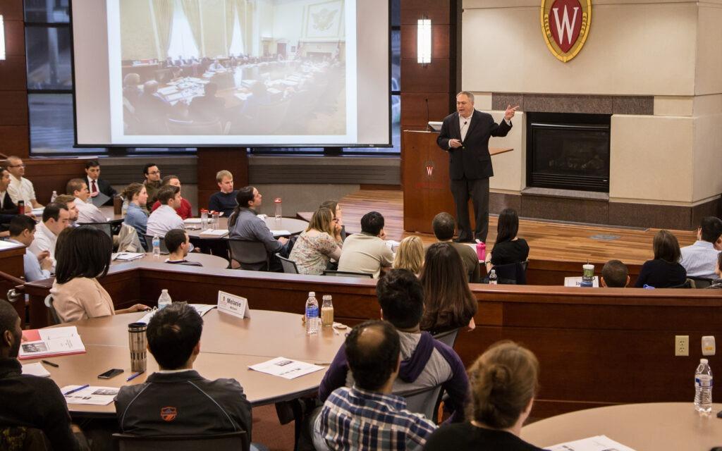 A speaker addresses students in Grainger Hall