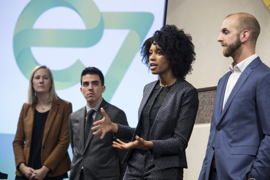 A woman presents the team project during the Case Competition