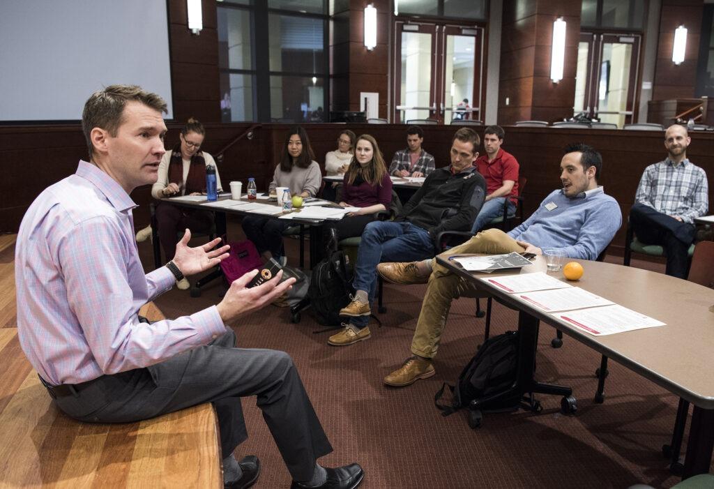 Students listening to leadership symposium