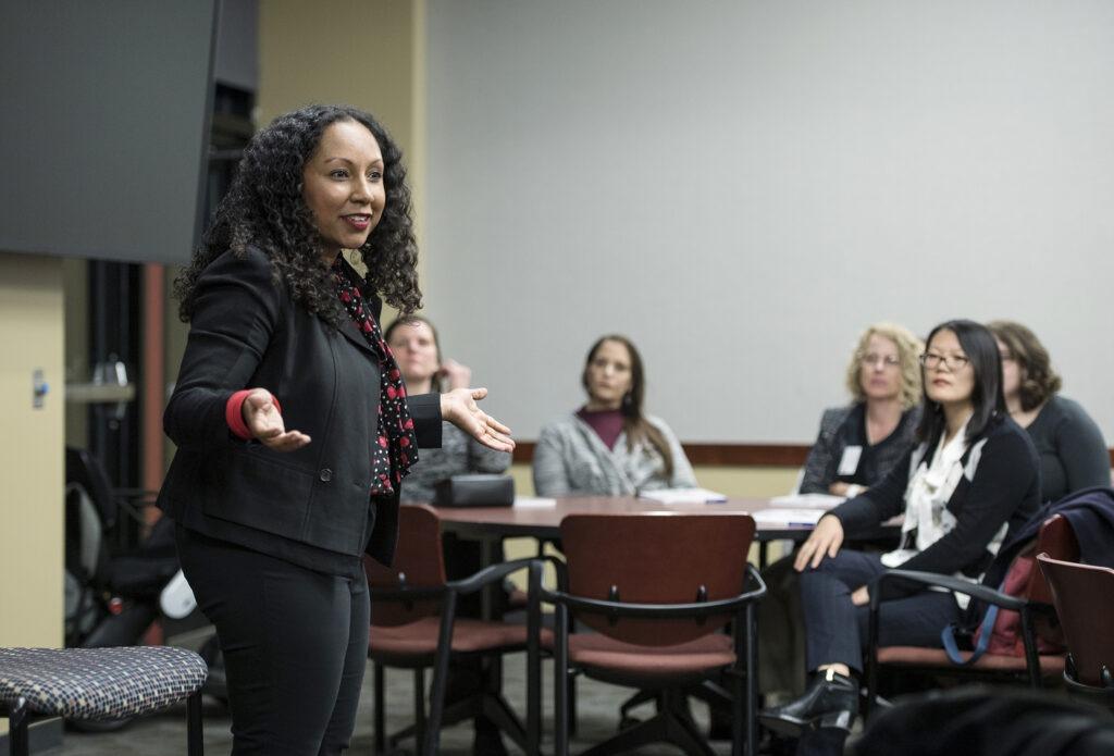 Weikel speaker Deanna Singh (MBA '12) speaks to a host of women MBA students
