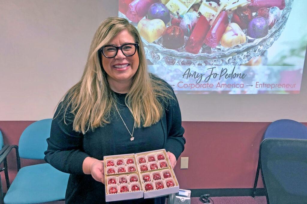 Amy Jo Pedone holding cupcakes